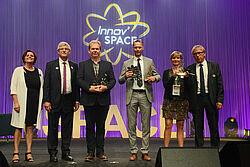 Uitreiking van de speciale prijs: de drie winnaars en SPACE-medewerkers